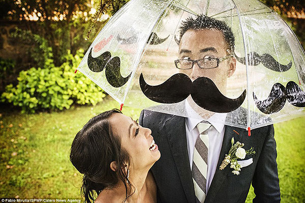 30129BCF00000578-3395422-A_perfectly_places_umbrella_makes_this_groom_look_like_he_has_gr-a-15_1452648256557