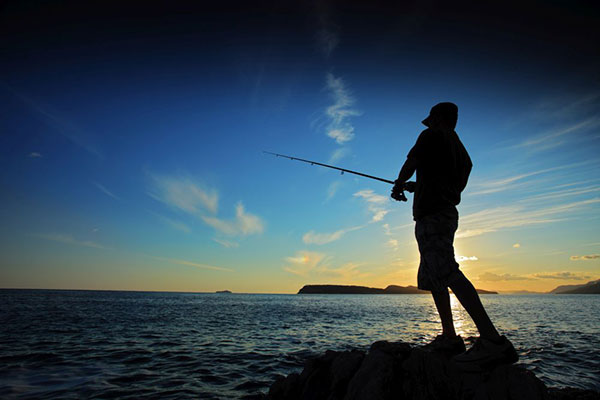 bigstock-Man-Fishing-5296546