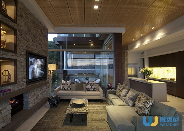 Sofas-Rug-Stone-Wall-Fireplace-Waterfront-Home-in-Vaucluse-Sydney
